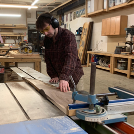 Sam using table saw