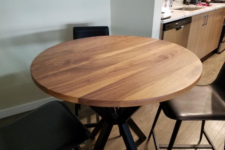 "36"" Walnut Round Table with Black Powder Coated Base"