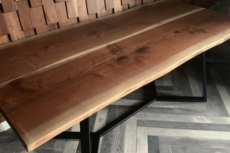 Walnut Live Edge Table in Restaurant with Custom Metal Base