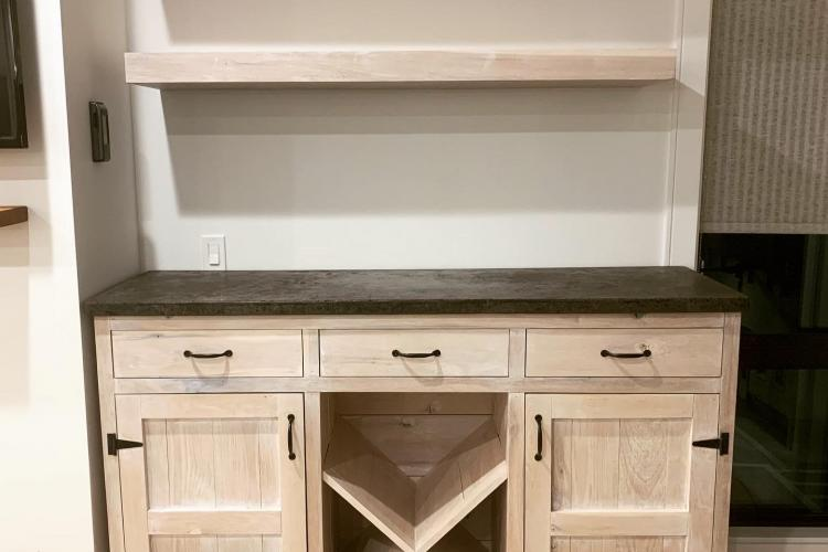 Whitewashed Cabinet with Concrete Top and Floating Shelves