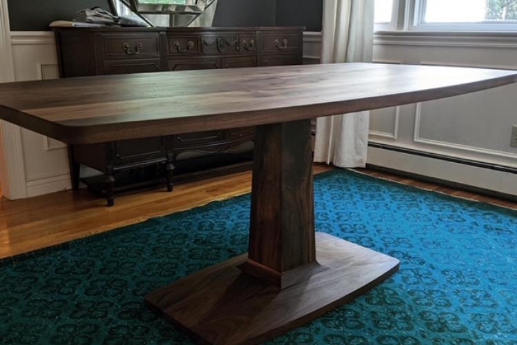 Curved Walnut Top with a Tapered Pedestal Base