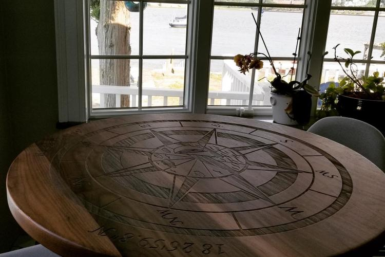 Laser Engraved Compass Rose Walnut Table in Waterfront Home