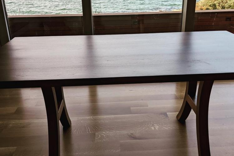 Curved Base on Oceanfront Walnut Table